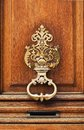 The ancient style carved knocker of the door Royalty Free Stock Image