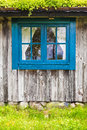 Ancient Swedish wooden farmhouse with blue window Royalty Free Stock Photo
