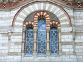 Ancient tall gothic stained glass window in the medieval church Royalty Free Stock Photo