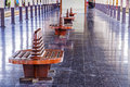 Ancient teak chairs platform seat at railway station Stock Photo