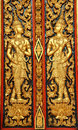 Ancient thai art traditional on a window shutter in a temple Stock Photos