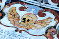 Ancient tombstone marble stained death a detailed view of the symbol of the with a skull from an in from a baroque church in Royalty Free Stock Photo