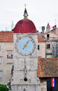 Ancient tower with a clock in trogir croatia vertical shot Stock Photos