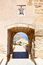 Ancient tower in fortress santa barbara with crying jesus icon alicante spain Stock Images