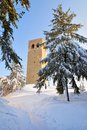 Ancient tower in the snowy field winter Royalty Free Stock Photos