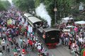 Ancient train passed through the crowd in solo central java indonesia Stock Photo