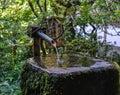 An ancient tsukubai stone water basin Royalty Free Stock Photo