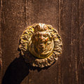 Ancient Venetian door with old door knob close-up Royalty Free Stock Photo