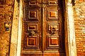 Ancient Venetian wooden door at night. Royalty Free Stock Photo