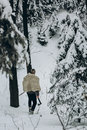 Ancient viking hunter walking in snow winter forest with steel a