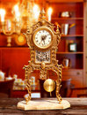 Ancient vintage brass pendulum clock Stock Photo
