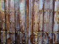 Ancient vintage wooden door with metal decorations