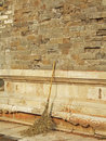 Ancient wall and broom Royalty Free Stock Photo