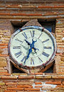 Ancient wall clock antique ruined on old brick Stock Images
