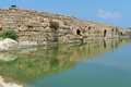 Ancient wall reflecting in the pond in Nahal Taninim archeological park, Israel Royalty Free Stock Photo