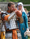 Ancient warrior after fight international festival of medieval culture in kiev ukraine in scale armour drinking water heavy Stock Image