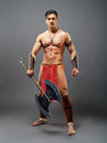 Ancient warrior half naked man in the image of on a gray background Stock Photo