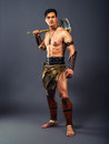 Ancient warrior half naked man in the image of on a gray background Royalty Free Stock Images