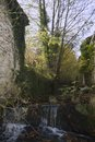 Ancient water mill and house ain river jura france at Royalty Free Stock Photography