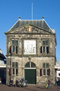 Ancient weigh house tourists and seniors netherlands province south holland city gouda the historic building the waag a city Royalty Free Stock Photography