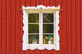 Ancient white window in a red wooden Swedish house Royalty Free Stock Photo