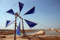 Ancient wind mill use for move the sea water into the salt field Royalty Free Stock Photo