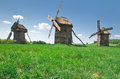 Ancient windmills in field Royalty Free Stock Images