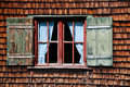 Ancient window on log house wooden wall Royalty Free Stock Images