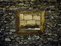 Ancient window in a stone wall with wine on the brick wall of hopelessness fortress dead end Stock Photo