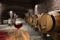 Ancient wine cellar interior with barrels Stock Images