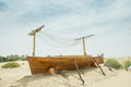 Ancient wooden boat on the sand in the desert uae Stock Photo