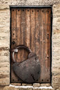 Ancient wooden door and big rusted lock locked padlock old fashioned safety concept Royalty Free Stock Image