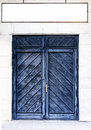 Ancient wooden door in stone castle wall. Royalty Free Stock Photo
