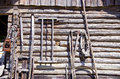 Ancient wooden etnographic barn wall with tools Royalty Free Stock Photography