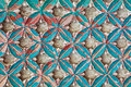 Ancient wooden flower pattern with blue accents Royalty Free Stock Images