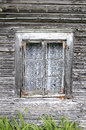 Ancient wooden window with a curtain in natural rural environment Stock Images
