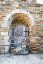 Ancient wooden window of medieval brick wall Royalty Free Stock Photo
