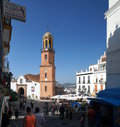 Andalusian village market square and church of competa a small town in the mountains about half an hour away from the Stock Photo