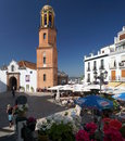 Andalusian village market square and church of competa a small town in the mountains about half an hour away from the Stock Photography