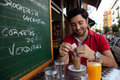 Andalusian young man having breakfast Stock Photo