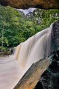 Anderson falls flow a beautiful wide waterfall in indiana s bartholomew county is photographed from below a large rock overhang at Stock Photos