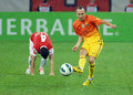 Andres iniesta of fc barcelona passes the ball after he dribbled an opponent player during a game between and dinamo bucharest Royalty Free Stock Image