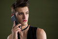 Androgynous man talking on mobile phone Royalty Free Stock Photo