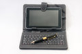 Android tablet and golden pen with keyboard Royalty Free Stock Photo