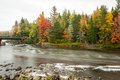 Androscoggin river in fall long exposure lends dreamy feel to water flowing down the new hampshire Stock Photography