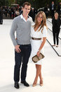 Andy murray and girlfriend kim sears arriving for the burberry prorsum catwalk show as part of london fashion week ss kensington Stock Photo
