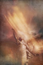 Angel ascending textured image of to the skies with colored light effects for book cover design Royalty Free Stock Photo