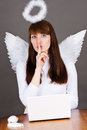 Angel asks for silence in heaven office Stock Photos