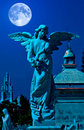 Angel in a cemetery at midnight Stock Image