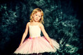 Angel child pretty little girl ballerina in tutu posing over vintage background Stock Image